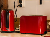 Electric kettle and toster on kitchen table Royalty Free Stock Photos
