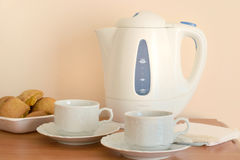 Electric kettle and two cups Stock Photos