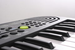 Electric keyboard / piano. Electric keyboard on a gray background Royalty Free Stock Images