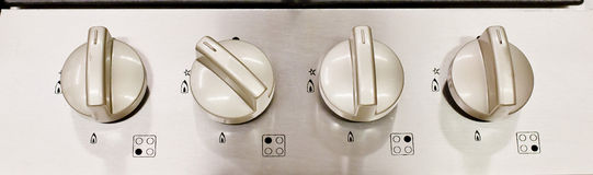 Electric kitchen stove control switch, black and white Royalty Free Stock Images