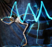 Electric Lady. Dancer with electric pulse Royalty Free Stock Photos