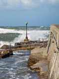 Electric Lamp in the Boardwalk near the Coastline hit by Sea Waves during Storm.  Stock Images