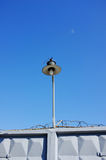 Electric lamp and  fence Stock Image