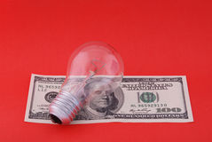 Electric lamp on hundred dollars Royalty Free Stock Photos
