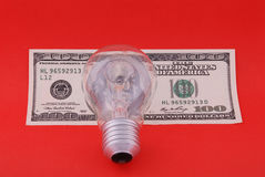 Electric lamp on hundred dollars Royalty Free Stock Photo