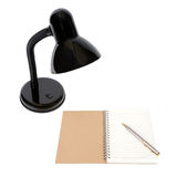 Electric lamp and note book with a pen. Royalty Free Stock Image