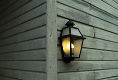 Electric lamp on a wall of  wooden house Stock Photo