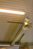 Electric lamps on celling indoor. Light power and energy. Royalty Free Stock Images