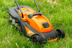 Electric lawn. Compact electric lawn mower for cutting lawns Stock Photos