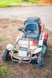 Electric lawn mower for cutting lawn. Equipment Royalty Free Stock Images