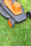Electric lawnmower on green grass Royalty Free Stock Image