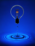 Electric light bulb with blue ripples Royalty Free Stock Photos