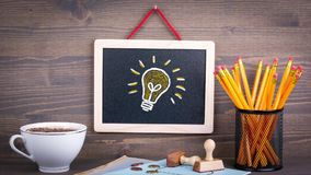 Electric light bulb on chalkboard stock video footage