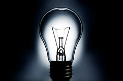 Electric light bulb with dark background Stock Images