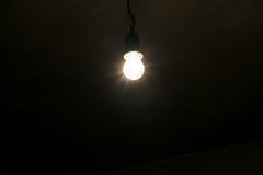 Electric light bulb on dark background Royalty Free Stock Photo