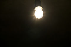 Electric light bulb on dark background Royalty Free Stock Image