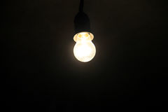 Electric light bulb on dark background Royalty Free Stock Photography