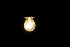 Electric light bulb on a dark background Stock Photos