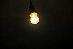 Electric light bulb on dark backround Royalty Free Stock Image