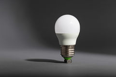 Electric light bulb on a gray background Stock Photo