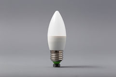 Electric light bulb on a gray background Stock Images