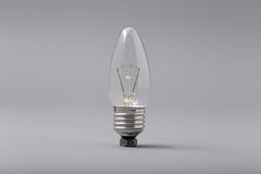Electric light bulb on a gray background Royalty Free Stock Photography