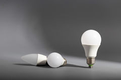 Electric light bulb on a gray background Stock Photography