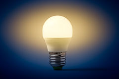 Electric light bulb on a gray background Stock Photos