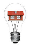 Electric Light Bulb and House inside Stock Images