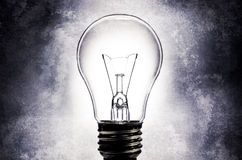 Electric light bulb with light textured background Stock Photography