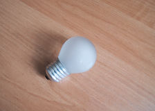 Electric light bulb. SONY DSC Electric light bulb on a wooden Board Royalty Free Stock Photography
