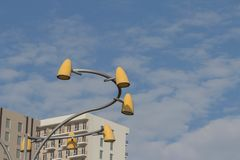 Electric light illumination in a town. Street lamp against sky and building background. Exterior decoration lamp in the city, scene with lamp. Electric light royalty free stock image