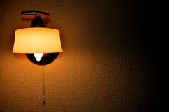Electric light. Electric lamp on the wall in a dark room Stock Photography