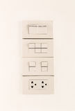Electric light switches in of position and sockets Royalty Free Stock Photography