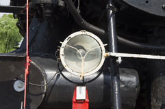 Electric lights mounted on the steam train of the 18th century Stock Photography