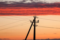 Electric line against colorful sky at sunset Stock Photo