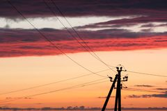 Electric line against colorful sky at sunset. Electric power line against colorful sky at sunset Royalty Free Stock Photo