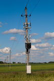Electric line in green fields Stock Photography