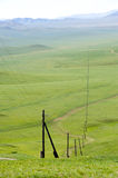 Electric line receding into the distance Stock Photo