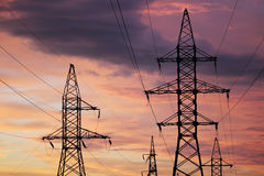 An electric line at sunset time Stock Images