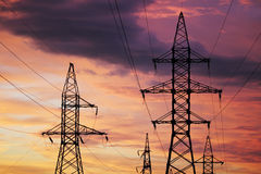 An electric line at sunset time Royalty Free Stock Image