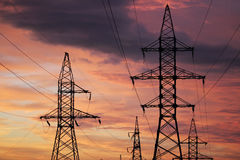 An electric line at sunset time Royalty Free Stock Photo