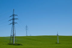 Electric lines. Electric pylons in Slovakia in the Rye Royalty Free Stock Photography