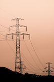 Electric lines. Silhouette of high voltage power lines and electric pylon Stock Image