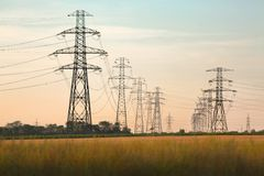 Electric lines on land Stock Photo