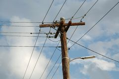 Electric lines on mast Stock Photos