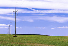 Electric lines. Electric power lines in the open flat landscape Royalty Free Stock Images