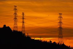 Electric Lines Silhouette at Sunset, Povoa de Lanhoso. stock photography