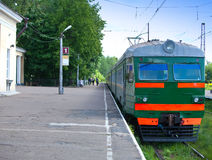 Electric local train at the platform in rural areas Stock Images