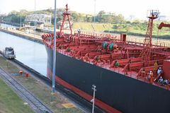 Electric Locomotive Guides Ship Through Panama Canal Royalty Free Stock Photo